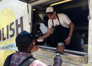 Foolish Waffles serves up their crowd-favorite pork belly bahn mi waffle.