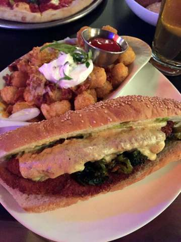 Chicken cutlet sandwich with a side of Baker Tots